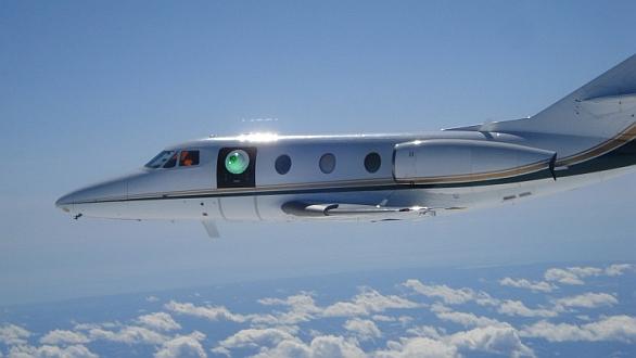Foto: Testování laserové střelecké věže ABC na malém obchodním tryskovém letadle. / Lockheed Martin