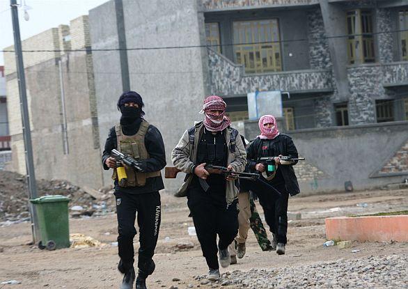 Foto: Ozbrojenci ve Fallúdži. / ČTK