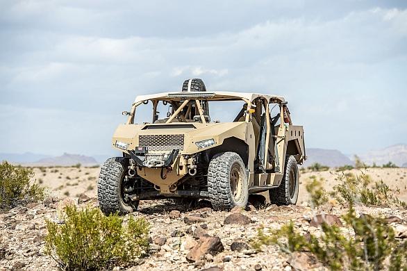 Foto: Firma Polaris nabízí pro potřeby americké lehké pěchoty terénní vozidlo Dagor; větší foto / Dagor